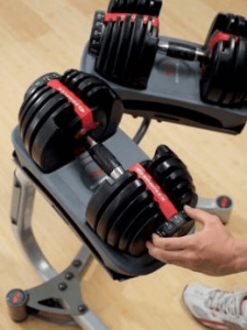 SelectTech 552 Adjustable Dumbbells, by BowFlex - Select weight by turning dial