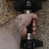 Lb and kg weight monitoring displays on SelectTech 560 Adjustable Dumbbell