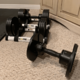 50 pounds Core Fitness adjustable dumbbells
