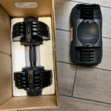 Unpacking ATIVAFIT 71.5 pound adjustable dumbbell
